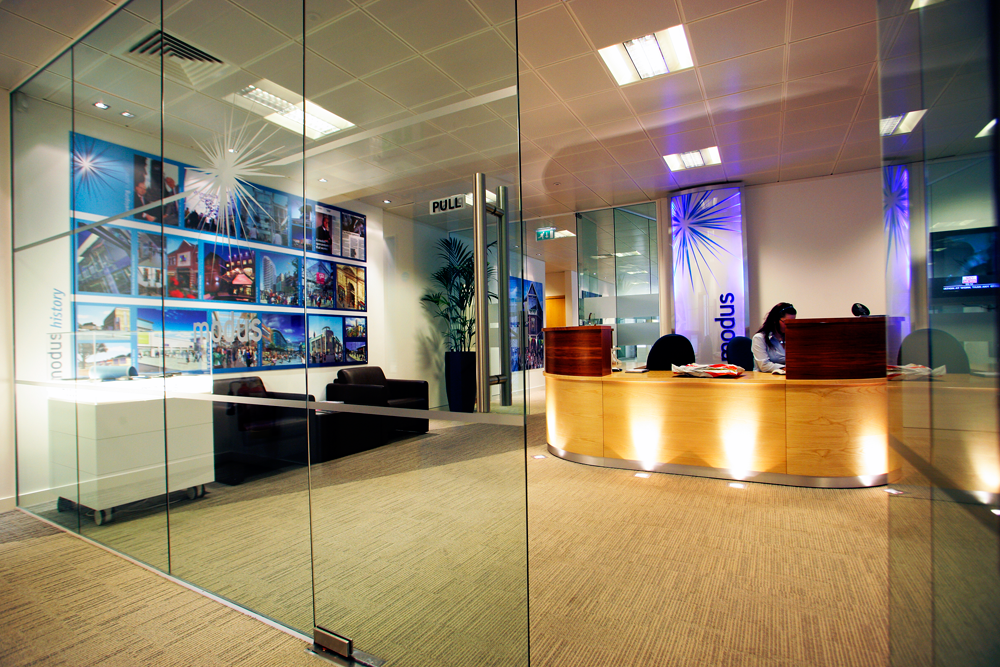 Why choosing glass doors can create the illusion of more for Office glass door entrance designs